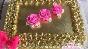 bolo rosa e dourado